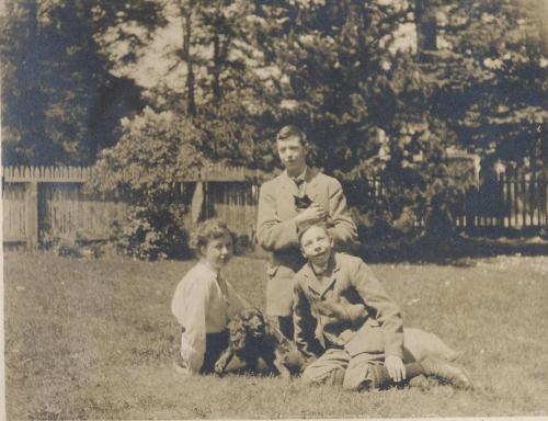 helen with noel and gterald on lawn in victoria with dog and cat